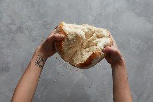 hand breaking Bread