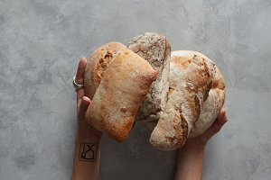 hand holding tasty fresh bread,