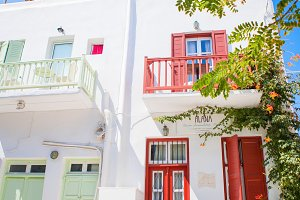 Traditional houses with colorful doors and windows in the narrow streets of greek village