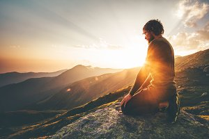 Man relaxing at sunset mountains