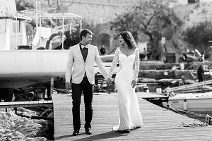 Wedding couple walking along a berth