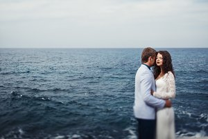 Couple stands calm by the sea