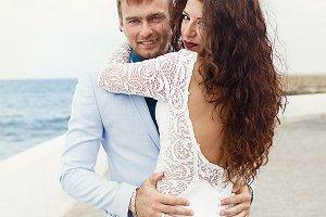 Stunning bride hugs groom