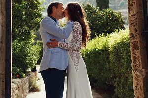 Groom kisses bride tender