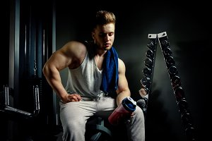 athlete with protein shaker