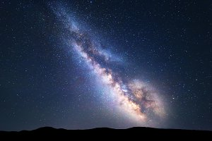 Colorful night landscape with bright milky way