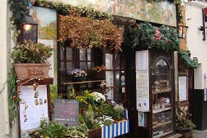 Flower Shop on a Cobblestone Road