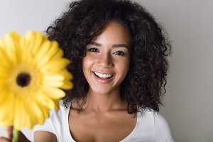 Woman with yellow flower