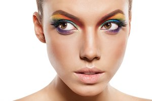 female face with rainbow makeup