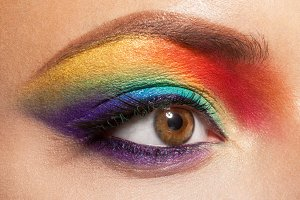female eye with rainbow makeup
