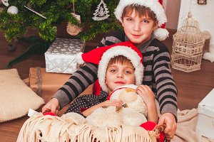 Two boys wearing Santa caps