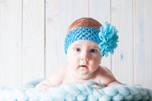Cute baby girl with blue bandage