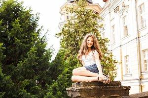 Girl near the hight school building