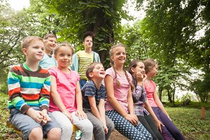 Group of children  on a park bench