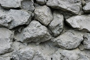 Texture of grey stone as background close up