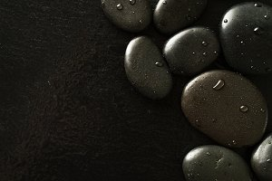 Spa Hot Stones on Black Background