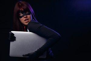 Woman thief cuddles stolen laptop