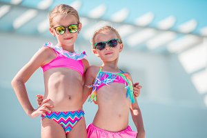Portrait of adorable little girls having fun on summer vacation