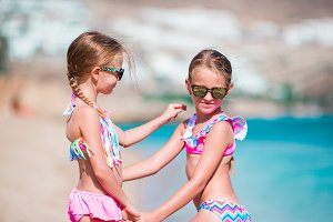 Two little girls together on the beach on caribbean vacation