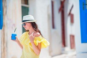 Beautiful woman walking in old greek streets in Mykonos