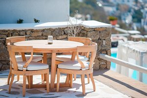 White tables with chairs at summer empty open air cafe in luxury hotel