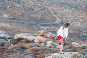 Adorable little girl in Greece walking in wild nature