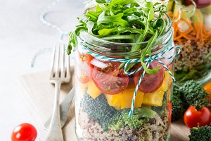 Salad in glass jar with quinoa