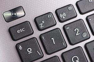 Close-up of buttons of a laptop keyboard. Computing.