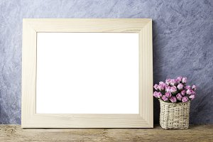 Paper rose and blank photo frame
