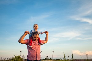 Cute boy with dad playing outdoor