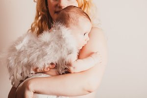 Portrait of mom with her baby angel