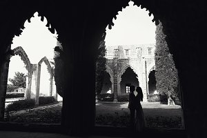 Couple standing under the old archs
