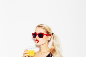 woman in sunglasses with cocktail