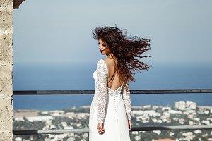 Wind blows woman's hair