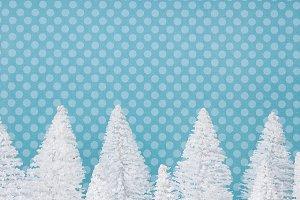White trees on blue Christmas