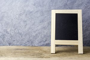 Blackboard with easel on old wood