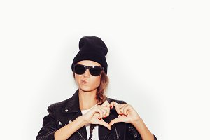 Girl in sunglasses Forming Heart