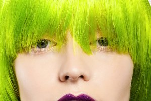 young woman in green wig