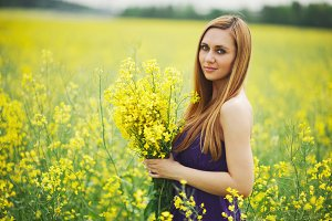 beautiful blonde girl on summer meadow