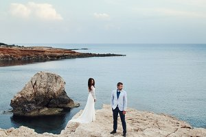 Sea azure surrounds a wedding couple