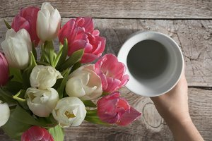 Bouquet of tulips and vase Photo
