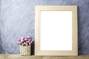 Pink rose and blank picture frame