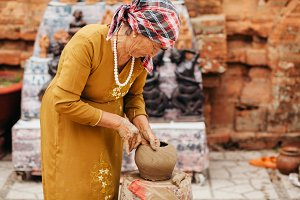 woman creates clay pot traditional