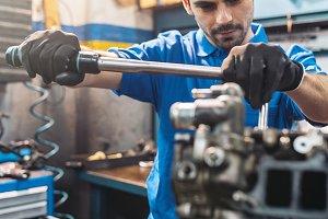 Mechanic Repairing Car Engine.
