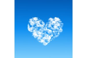 heart shaped cloud in blue sky.