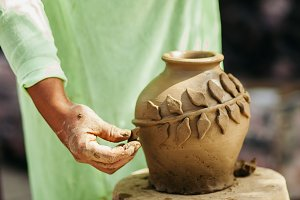 woman's hands with clay pot