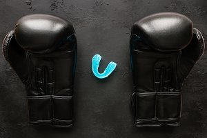 boxing gloves and a mouth guard