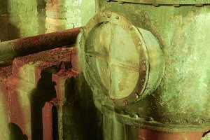Leakage in the hatch on the pipe. Old equipment. Basement of a w