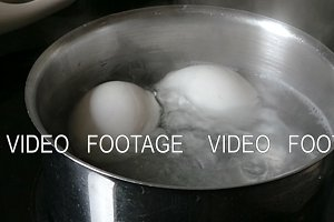 Eggs are boiled in a saucepan