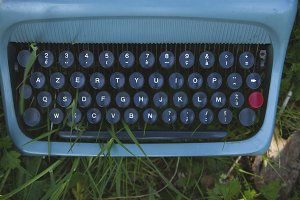 vintage typewriter among the grass